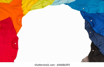 Colorful t-shirts stacked color isolated background .
