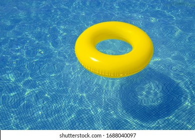 Colorful tube floating in a swimming pool, summer vacation concept