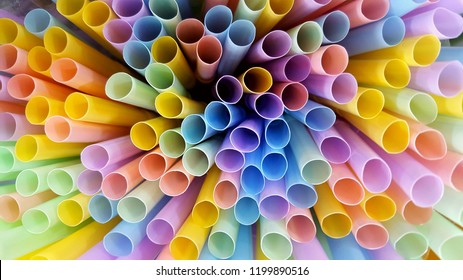 Colorful tubes put together in the cylinder glass.