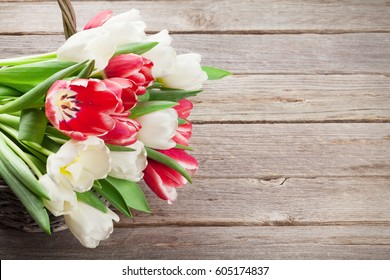 Colorful tulips bouquet basket. Red and white. With space for your greetings