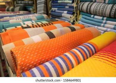 Colorful Tunisian fouta beach towels on display in a shop