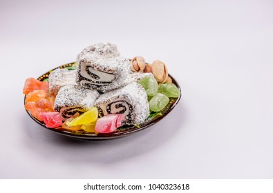 Colorful Turkish Delight Lokum with nuts on plate. A traditional Eid al fitr sweet.