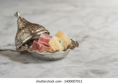 colorful turkish delights in a bowl on table
