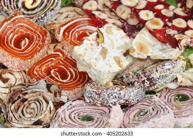 Colorful Turkish delights with nuts and chocolate