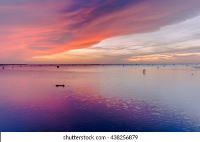 Colorful twilight reflection of sunrise on cloud in the morning over  estuary.