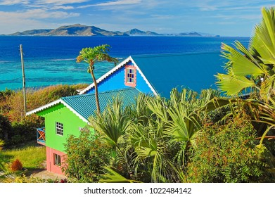 Colorful typical houses on shore of Union island, Caribbean Sea