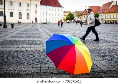 Colorful umbrella on cobblestones