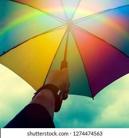 Colorful umbrella with rainbow