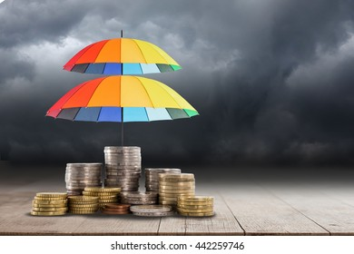 Colorful umbrella for saving money. Protection investment concept.