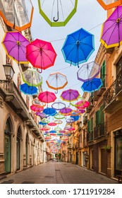 Colorful umbrellas along a street in Sardinian town