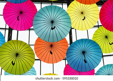 Colorful Umbrellas background falling from the sky