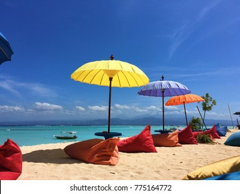 Colorful umbrellas and beanbags on a beach