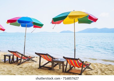 colorful umbrellas and deck chairs on the beach