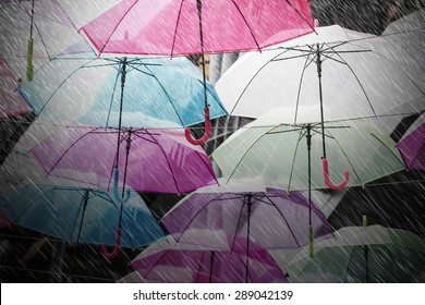 Colorful umbrellas decoration in rainy day