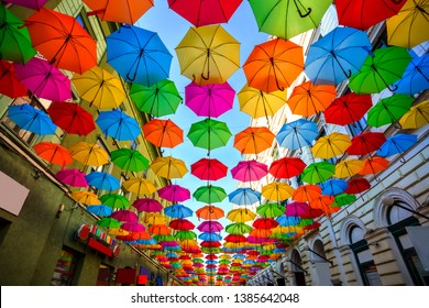 Colorful umbrellas hanging out above the old streets of Timisoara city center, Romania. Photo taken on 21st of April 2019.
