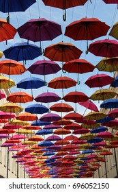 colorful umbrellas hung above a shopping street