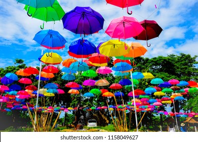 9b12c8e4f Colorful umbrellas on the blue sky on a bright day, bright colors of the  summer