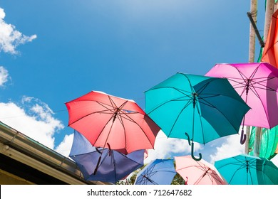 colorful umbrellas protecting the sunlight with clear blue sky