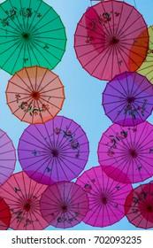 Colorful umbrellas in the sky
