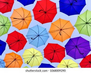 Colorful umbrellas in the sky background