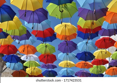Colorful umbrellas in the sky. Street decoration. Colorful background.
