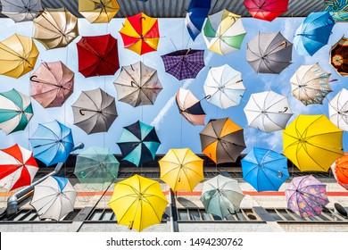 Colorful umbrellas as urban art in the city of Zürich, Switzerland - Shutterstock ID 1494230762