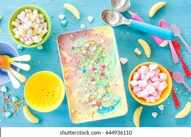 Colorful unicorn ice cream and sugary sprinkles