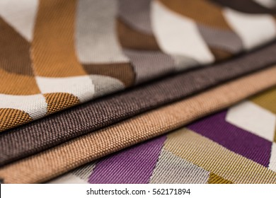 Colorful upholstery fabric samples background. Abstract background, empty template.