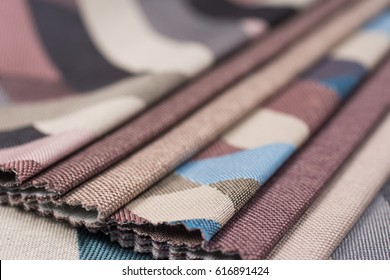 Colorful upholstery fabric samples background. Abstract background, empty template. Selective focus.