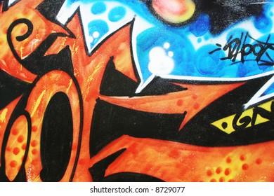 Colorful urban wall graffiti art.