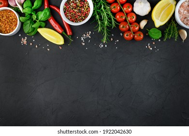 Colorful various herbs and spices for cooking on dark background, copy space, mock up. High quality photo