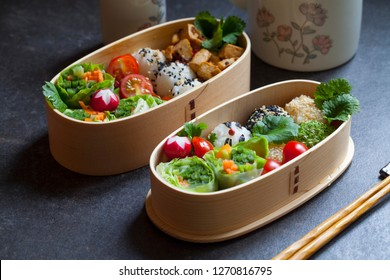Colorful vegan bento lunch box with green vegetables and tofu