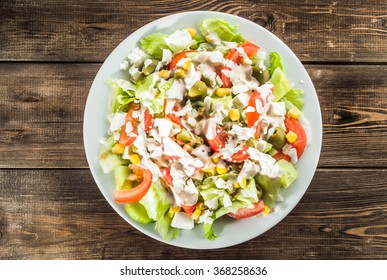 Colorful vegetable salad with tomato and lettuce.