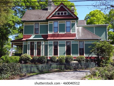 A colorful Victorian Gingerbread house in a quaint North Carolina neighborhood.
