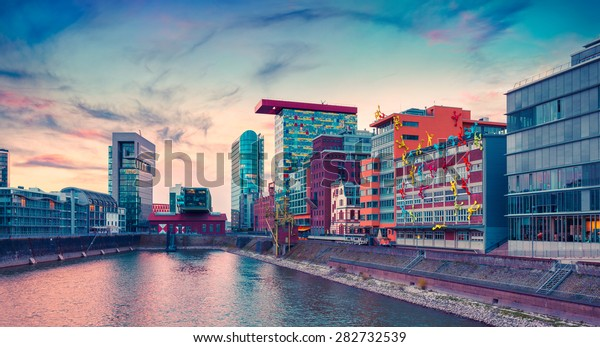 Colorful view of Rhine river at evening in Dusseldorf. Medienhafen in the soft sunset light, Nordrhein-Westfalen, Germany, Europe. Instagram toning.