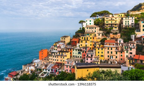 The colorful village of Riomaggiore, Cinque Terre, Italy, on a lovely summer morning. Old traditional Italian terraced houses built at the seaside.