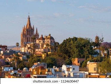 Colorful vista of San Miguel de Allende in Mexico from a high vantage point, including the church, Parroquia de San Miguel Arcangel.