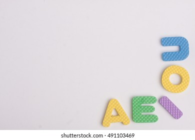 Colorful vowel letter on isolated background with copy space