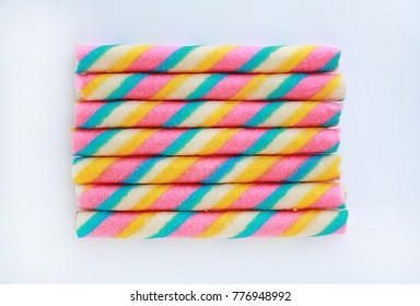 Colorful wafer roll stick isolated on white background.