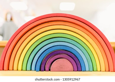 Colorful Waldorf wooden rainbow in a montessori teaching pedagogy classroom.