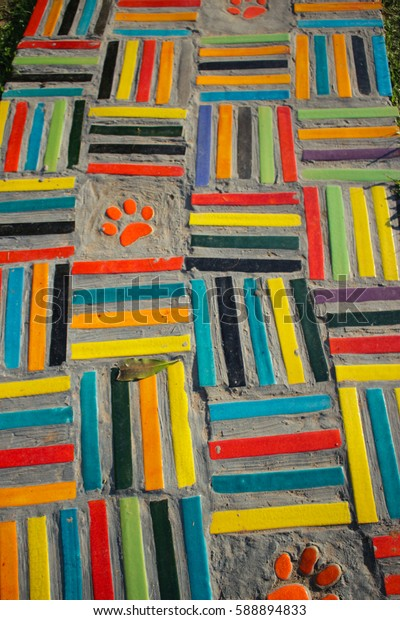 Colorful walk path with dog foot prints