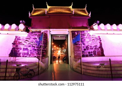 Colorful wall and bastion with gate entrance at night in Nakhon Ratchasima downtown, Thailand