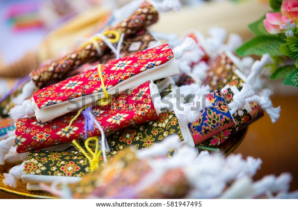 Colorful of wallet wedding souvenir, made from thai fabric pattern