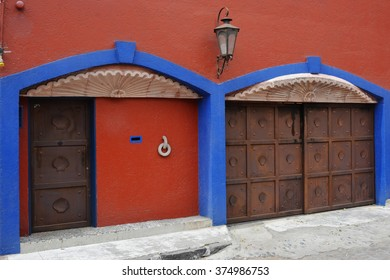 Colorful walls and gates in the historic Coyoacan neighborhood of Mexico City.