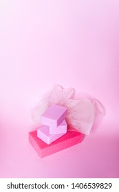 Colorful washcloths and bars of soap on a soft background. Accessories for body care and hygiene.