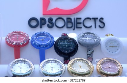 Colorful watches woman wrist of famous brand in the window of the shop Campobasso, Italy, February 9, 2017