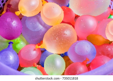 Colorful water balloons in a basket