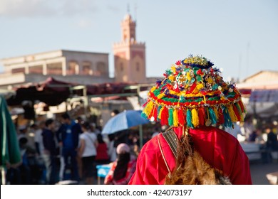 Colorful water bearer in Marrakech, Morocco. In the past, water bearers were men who brought some water with them to quench the thirst of people. To be easily recognizable they wore colorful dresses.