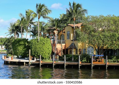 Colorful water front home on the intracoastal waterways in Fort Lauderdale, Florida, USA.