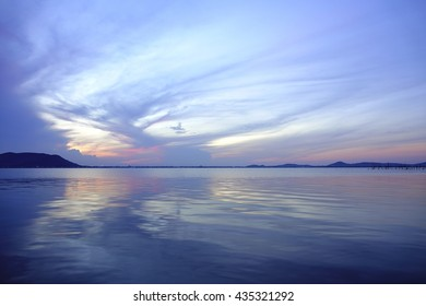 Colorful water reflective sky before sunrise at lake with silhouette downtown and Island in foreground,select focus with shallow depth of field:ideal use for background.